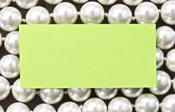 White pearl and card Royalty Free Stock Images