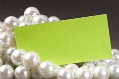 White pearl and card. White pearl and blank card Stock Photography