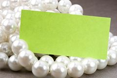 White pearl and card Royalty Free Stock Photography