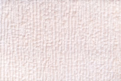 White pearl fluffy background of soft, fleecy cloth. Texture of textile closeup. Royalty Free Stock Photo