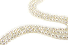 White Pearl Necklace. Against a white background Stock Photos