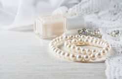 White pearl necklace on handmade lace background. Stock Photography