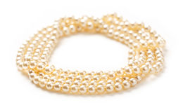 White pearl necklace of many strings Stock Photos