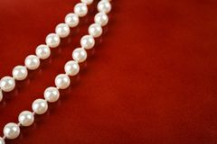 Free White Pearl Necklace On Red Background Stock Image - 128527531
