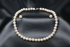 White pearl necklace with pearl earrings Stock Image