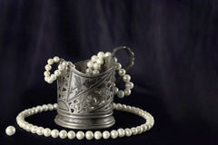 White pearl necklace and silver cup Royalty Free Stock Photo
