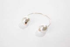 White pearl pieced earring. On white bacground Royalty Free Stock Photo