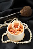 White pearl with powder in a box Stock Photos