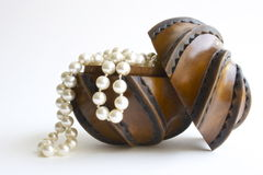 White pearls. In a wooden unique box Stock Photos