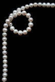 White pearls on the black velvet Royalty Free Stock Photos