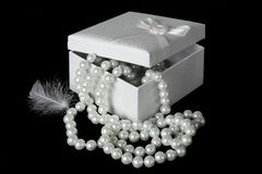 White Pearls and Feather Royalty Free Stock Photography