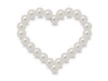 White pearls in a heart shape Royalty Free Stock Images