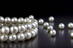 White pearls necklace on black Stock Photo