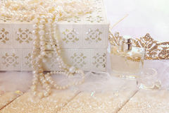 White pearls necklace, diamond tiara and perfume bottle Stock Photography