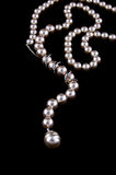 White Pearls Necklace On Black Stock Image