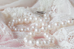 White pearls necklace on toilette table. Selective focus. Stock Photo