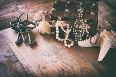 White pearls necklace in treasure chest next to seashells Stock Images