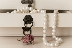 White pearls necklace in a wooden casket Stock Photos