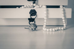 White pearls necklace in wooden casket Stock Photo