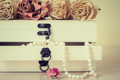 White pearls necklace in wooden casket Royalty Free Stock Image