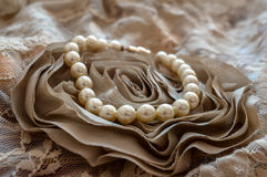 White Pearls. On an old lace rose Stock Photography