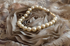 White Pearls. On an old lace rose Royalty Free Stock Photography