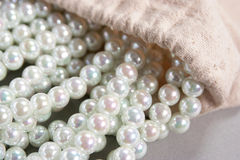 White pearls poured out of the bag Royalty Free Stock Image