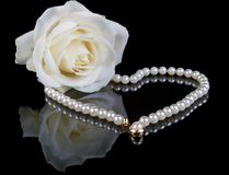 White pearls and rose royalty free stock images