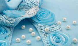White pearls scattered on turquoise ribbon and silver cord with Stock Photos