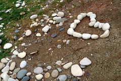 White pebble heart. On a small hill by the sea stock photography