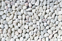 White pebble stones as background Stock Photography
