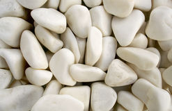White pebble stones as background Stock Images