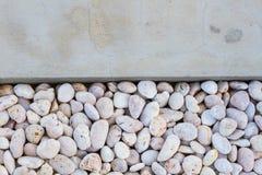White pebble stones with gray concrete ground Royalty Free Stock Photo