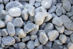 White pebbles. Background with white patterned river pebbles Stock Photo