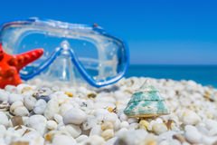 White pebbles and diving mask Royalty Free Stock Images
