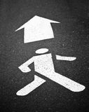White Pedestrian Symbol Painted over Black Asphalt with Arrow Si Royalty Free Stock Photo