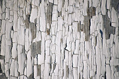 White peeling paint. Background of white, peeling paint on an old wall Stock Photo