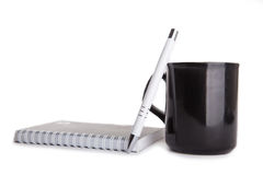 White pen, notebook and coffee cup Stock Photo