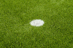 The white penalty point on the artificial green grass soccer field Stock Image