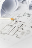 White pencil on architectural for construction drawings. With roll of blueprint stock photo