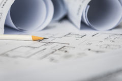 White pencil on architectural for construction drawings. With roll of blueprint royalty free stock image