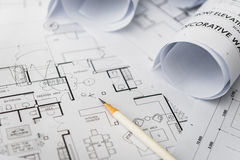 White pencil on architectural for construction drawings. With roll of blueprint stock photos