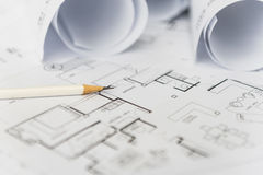White pencil on architectural for construction drawings. With roll of blueprint stock photography