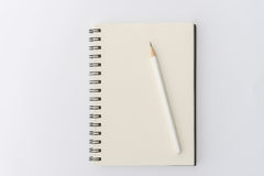 White pencil with blank notebook on white Royalty Free Stock Images