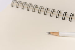 White pencil with blank notebook on white Stock Image
