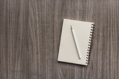 White pencil with blank notebook Royalty Free Stock Photo