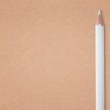 White pencil on carton background Stock Photo