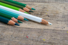 White pencil and many green pencil Stock Photography