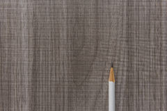 White pencil on wooden table Royalty Free Stock Photos