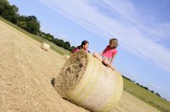 White people having fun on hay bales Royalty Free Stock Photography